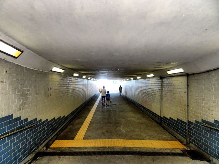 Pursue some path, however narrow and crooked, in which you can walk with love and reverence. City Illuminated Men Full Length Futuristic Tunnel Women Architecture Built Structure