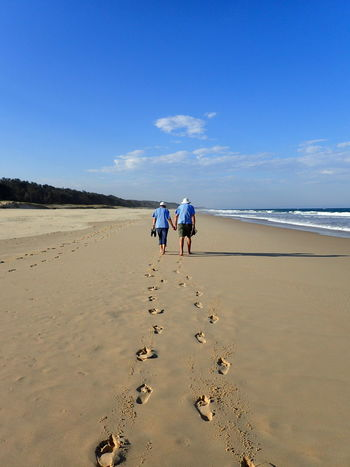 Hand in Hand Bonding Old Age Security Leading Lines Love Walking By The Beach Beach Beachscape Beauty In Nature Bonding FootPrint Full Length Nature Outdoors Real People Rear View Sand Scenics Sea Sky Togetherness Tranquility Two People Vacations Walking Water Tranquil Scene Blue Horizon Over Water Standing #FREIHEITBERLIN Summer Road Tripping
