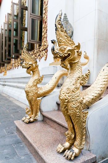 Dragon sculptures on steps outside buddhist temple