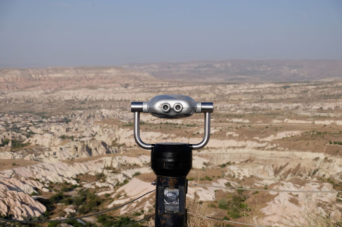 Lookout binoculars from Uchisar Kalesi, Cappadocia Cappadocia Lookout Turkey View Beauty In Nature Clear Sky Close-up Coin-operated Binoculars Day Landscape Mountain Mountains Nature No People Outdoors Scenics Sky Tourism Uchisar Kalesi ... Uchisarcastle Uçhisar