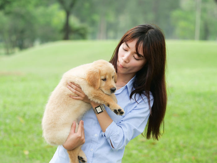 Adult Canine Dog Domestic Domestic Animals Embracing Emotion Focus On Foreground Hair Hairstyle Happiness Love Mammal One Animal One Person Pet Owner Pets Positive Emotion Teenager Waist Up Women