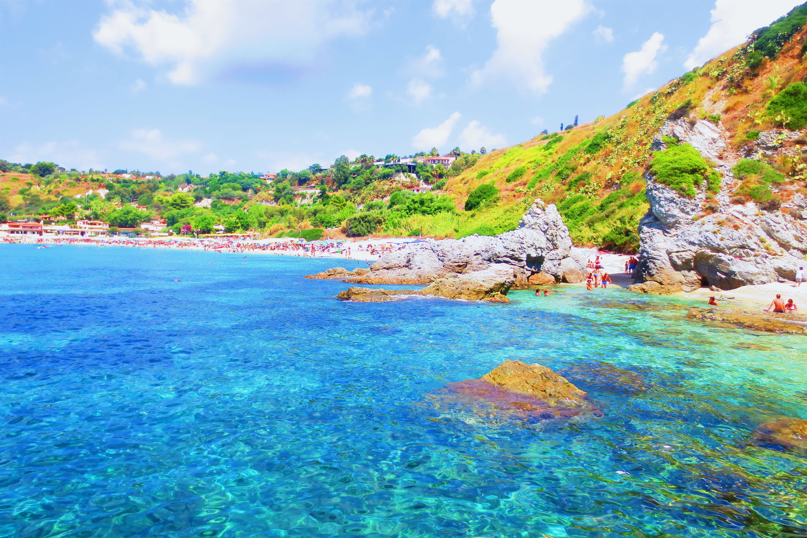 water, sky, tranquility, sea, tranquil scene, scenics, beauty in nature, nature, blue, tree, cloud - sky, rock - object, idyllic, mountain, cloud, day, coastline, turquoise colored, rock formation, outdoors, non-urban scene, remote, green color, no people, growth, grass, plant, landscape, calm
