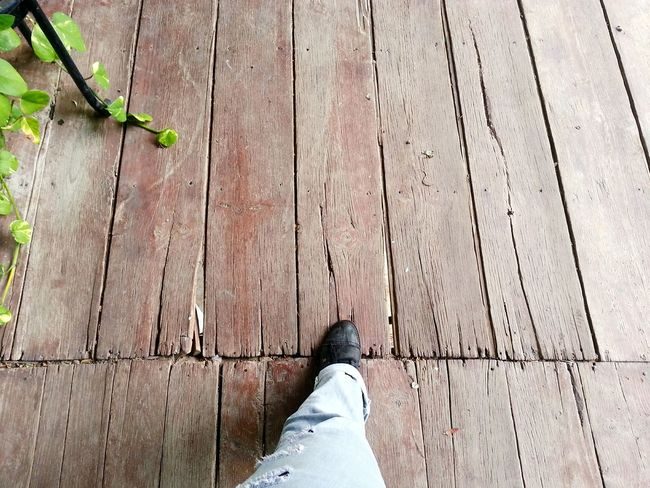 Human Body Part Low Section Shoe Limb Human Foot Wood - Material Personal Perspective Standing One Person High Angle View Hardwood Floor Directly Above Adult Jeans Ripped Jeans Floor Flooring Walking Around Pathway