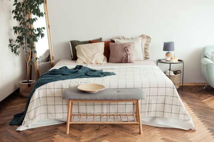Table and chairs on bed against wall at home