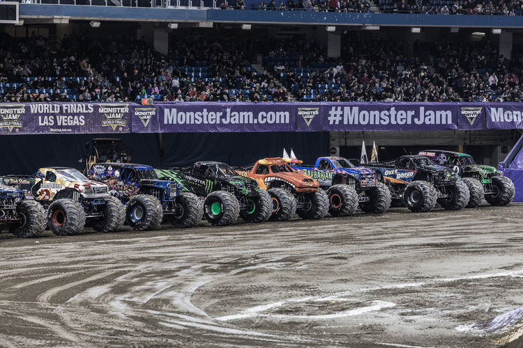Jump Monster Jam Monster Trucks Abundance Competition Crowd Day Outdoors People Sport Text Truck Trucks