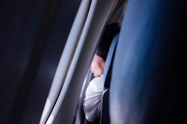 Airplane Casual Clothing Close-up Day Leisure Activity Lifestyles Light Male Man Part Of Seat Water