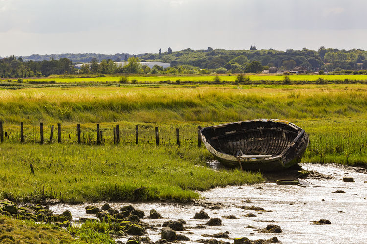 Old rowboat, Faversham, England, United Kingdom Agriculture Beauty In Nature Day Field Grass Green Color Landscape Nature Nautical Vessel No People Outdoors River Riverbank Rural Scene Scenics Sky Tranquil Scene Tranquility Water Watermill
