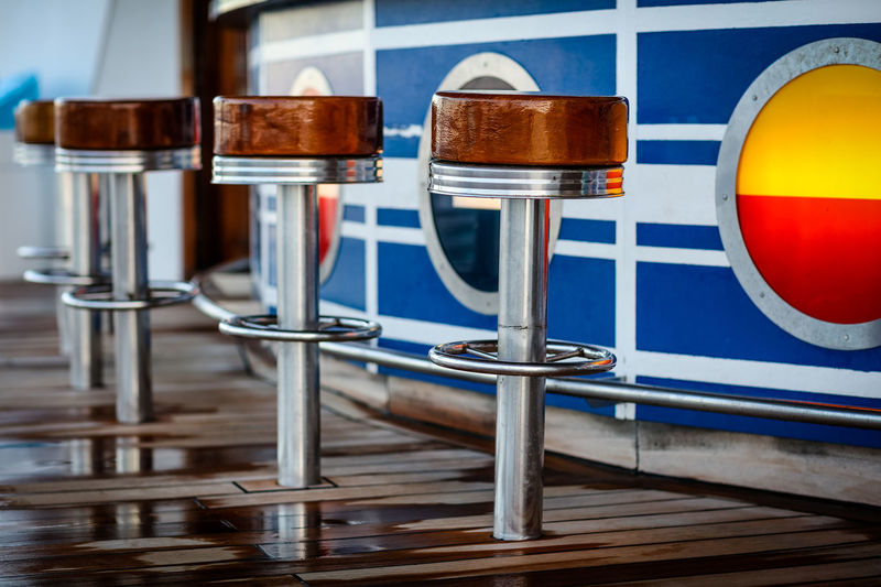 At the bar At Sea At The Bar Bar Bar Chairs Cruise Cruise Ship Day Freedom Of The Seas No People Pool Bar Pool Deck Poolside Sailing Seats Stools Adventures In The City The Traveler - 2018 EyeEm Awards