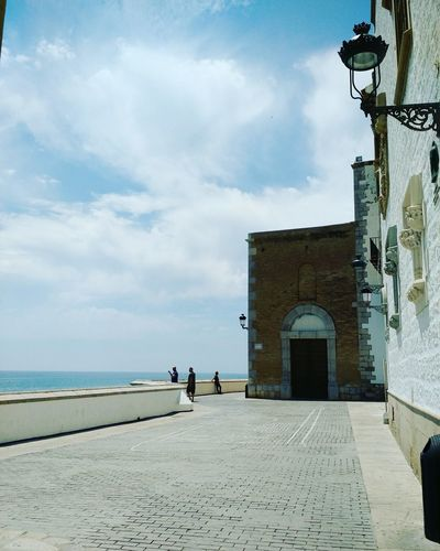 Sky Architecture Cloud - Sky Men People Adult Outdoors Sea Only Men Adults Only Day Sitges Barcelona España Nature Spainish Architecture, Spain Architecture City Horizon Over Water Places To See Romantic Ancient City Sunlight History Blue Water Travel Destinations