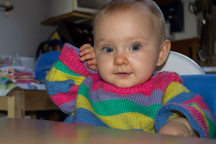 little child with big blue eyes in colorful sweater sitting at kitchen table looking at camera Kitchen Home At Home Home Interior European  Caucasian Caucasian Ethnicity Blue Eyes Blue Toddler  Toddlerlife Baby Babyhood Cute Sweet Adorable Child Childhood Sitting Looking At Camera Front View Real People Indoors  Blond Hair Blonde Blond Human Face Portrait Innocence Indoors  Colorful Pullover Knitted Sweater One Person Young Focus On Foreground Toddler  Headshot Lifestyles