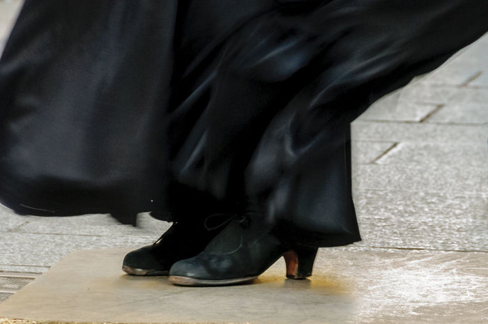 A close view of a pair of female black flamenco shoes who was street performing in in Madrid. Black Shoes Black Skirt Dancer Editorial  Editorialphotography Entertainment Flamenco Street Entertainment Streetphotography Travel Woman