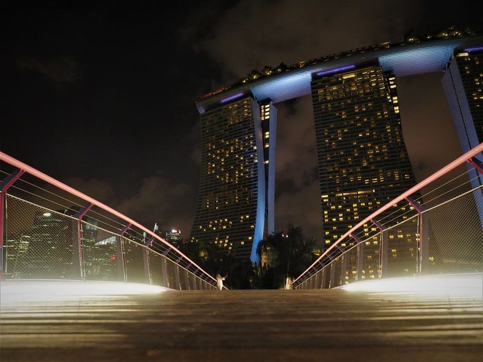 Marina Bay Sands Hotel Singapore Architecture Blurred Motion Bridge Building Building Exterior Built Structure City Cityscape Connection Footbridge Illuminated Lighting Equipment Low Angle View Modern Nature Night No People Office Building Exterior Outdoors Railing Sky Skyscraper Transportation Travel