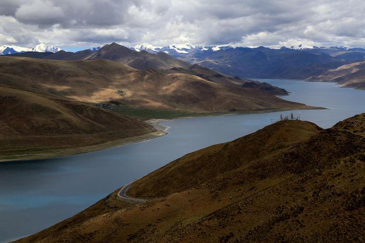 Calm lake along rocky landscape