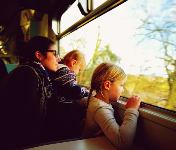 Woman With Children Looking From Train Window