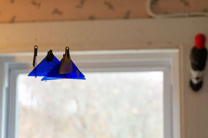 Mom's attic Woodpecker Attic Visiting My Mom Bangor, Maine Wind Chime No People Hanging Day Low Angle View Blue Nature Outdoors Triangle Shape Decoration Focus On Foreground Geometric Shape