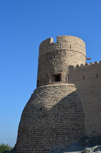 Architecture Blue Sky Built Structure Day Fort Fortress Fujairah Historical Building History Man Made Structure No People Outdoors Sky Stone UAE United Arab Emirates The Architect - 2017 EyeEm Awards