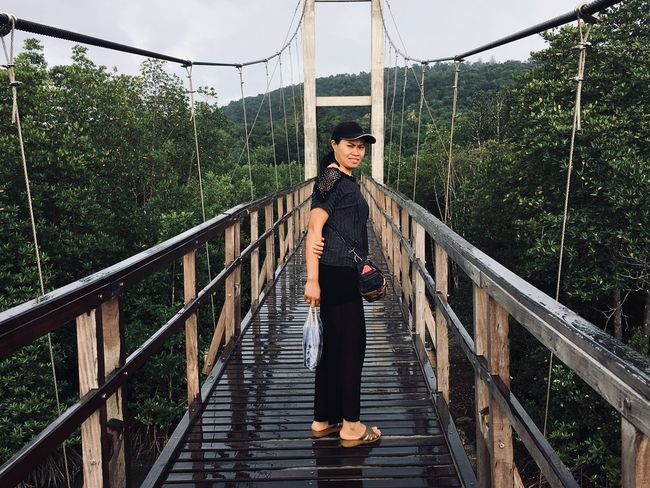 One Person Young Adult Railing Real People Full Length Young Women Built Structure Standing Connection Nature Plant Front View Bridge Lifestyles Casual Clothing Architecture Women Leisure Activity Tree
