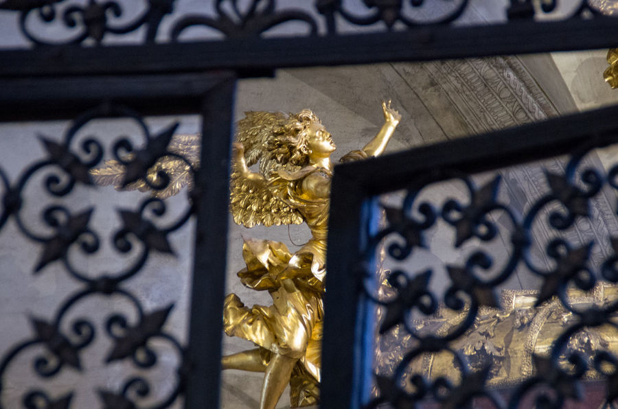 A Angel Architecture Church Church Of The Brothers Close-up Day Europe Gold Gold Colored Human Representation Iron Gate Italy Low Angle View No People Outdoors Renaisa Santa Maria Gloriosa Dei Frari Sculpture Statue Venice Venice, Italy