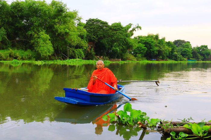 Water Tree Lake Nature Reflection Nautical Vessel Real People Lifestyles Outdoors Tranquility Leisure Activity One Person Beauty In Nature Day Men Vacations One Man Only Monk  Buddhist Priest