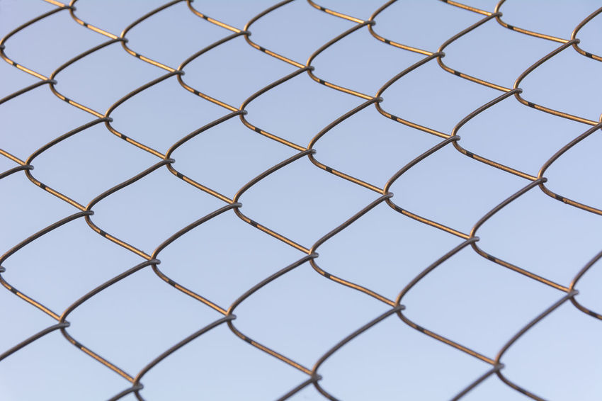 Backgrounds Full Frame Pattern No People Design Close-up Day Shape Indoors  Fence Metal Geometric Shape Nature Repetition Clear Sky Protection Blue Connection Boundary