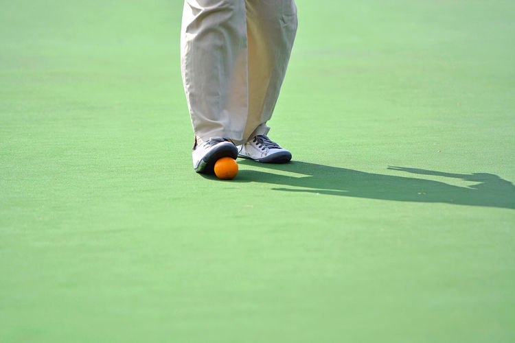 Man and Lawn bowl on the green field Lawn Lawn Bowls Bowl Bowling Outdoor People Athlete Man Backgrounds Ball Business Green Field EyeEm Selects EyeEm Best Shots EyeEmBestPics Eyeemphotography Healthy Golfer Golf Course Sportsman Golf Club Low Section Golf Sport Men Green - Golf Course Competition Human Foot Track And Field Event