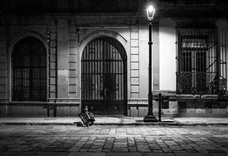 Past Her Bedtime Arch Architecture Building Building Exterior Built Structure Door Entrance Illuminated Musician Night One Person Social Issues Street Streetphotography Tourism