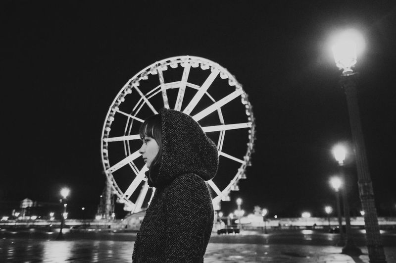 Wheeler Alone Beauty Brunette City Coat Ferris Wheel Girl Lights Linas Was Here Night Profile Roue De Paris Tourist The Traveler - 2018 EyeEm Awards The Art Of Street Photography