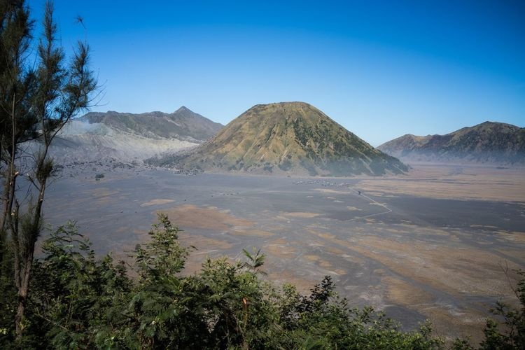 Scenic view of volcanic mountain against blue sky at mount bromo, java, indonesia.