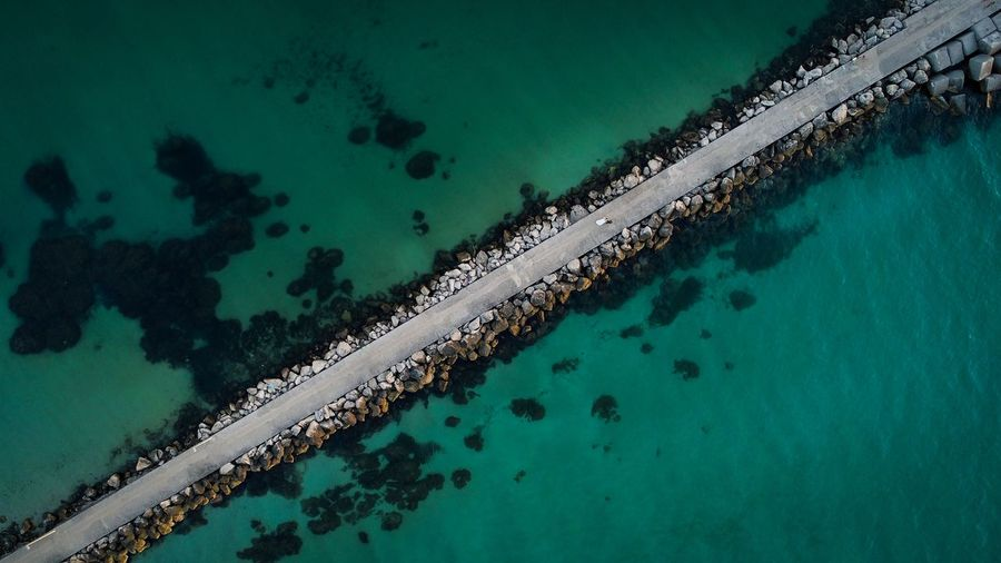 Aerial view of pier amidst sea