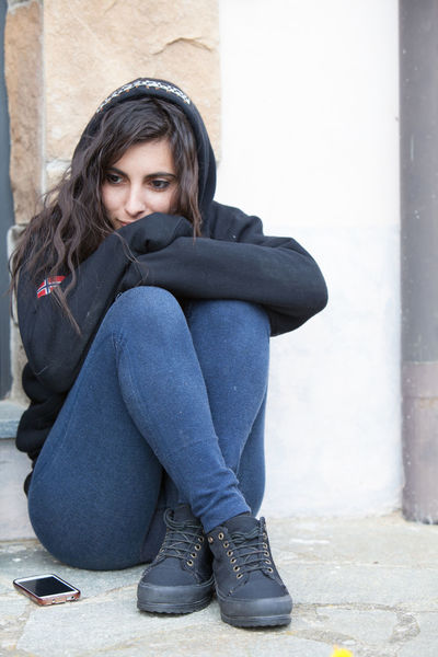Girl thinking Black Hair Casual Clothing Casual Look Day Emotion Front View Full Length Girl Girlfriend Hug Yourself Jacket Laisure Leaning Leisure Activity Lifestyles Portrait Standing Thinking Thinking About Life Thoughts Tough Life Toughts Young Adult Young Woman Young Women