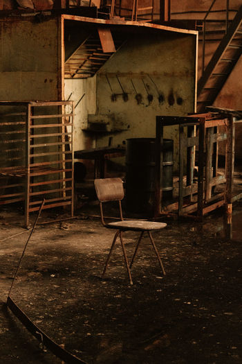 Empty chairs in abandoned building