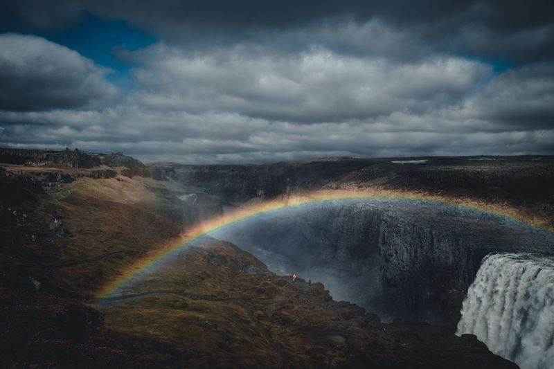 Scenic view of rainbow over rock formation
