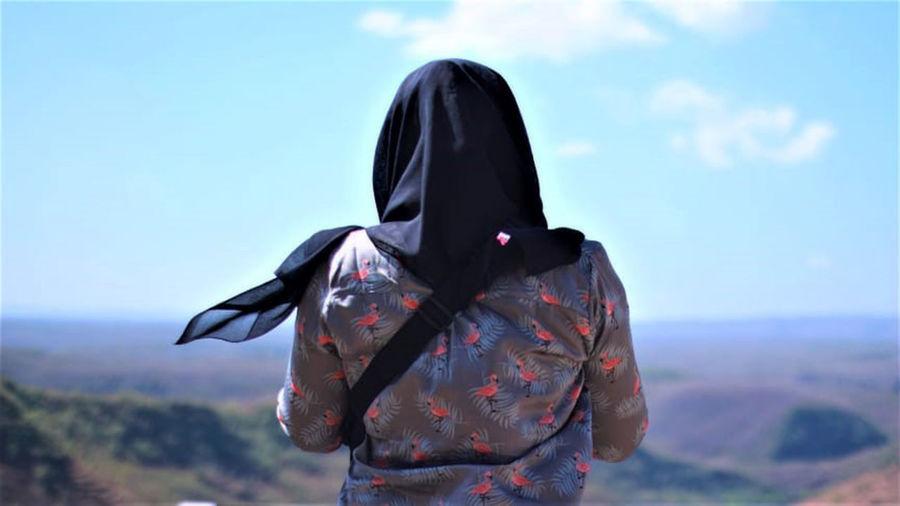 Rear view of woman against landscape