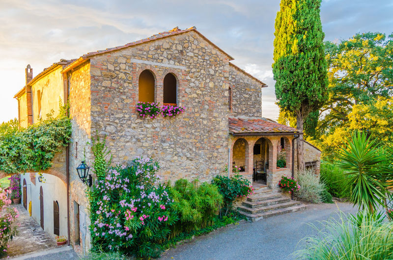 Beautiful old Itanlian stone house with arched windows and typical plants during sunset, Banjo di Gavorano, Italy Beautiful Home Tuscany Arch Architecture Beauty In Nature Building Exterior Built Structure Cloud - Sky Day Flower Growth History House Italian Italy Nature No People Outdoors Plant Rock - Object Sky Stone Sunset Tree