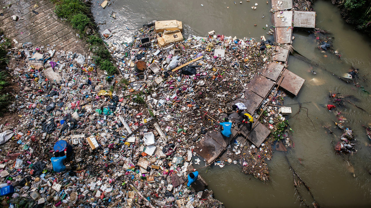 garbage, high angle view, pollution, large group of people, men, crowd, day, real people, waste management, outdoors, adult, people