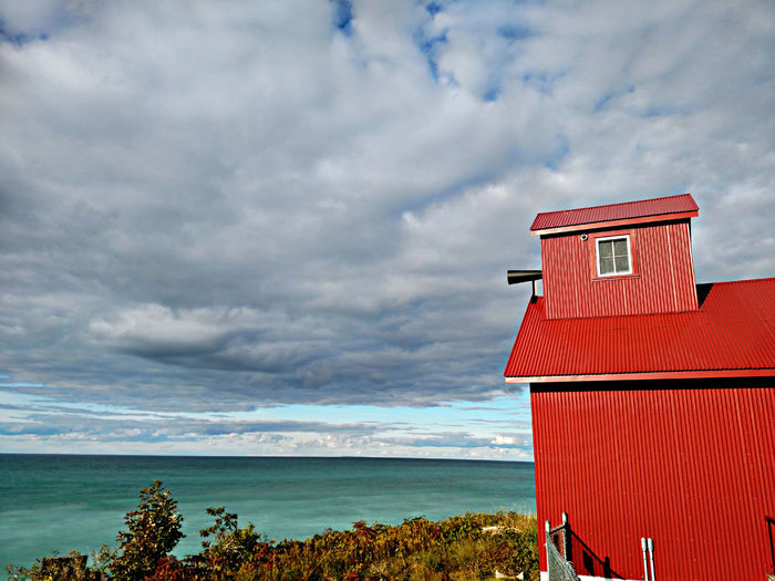 Red Hut At Beach Against Sky
