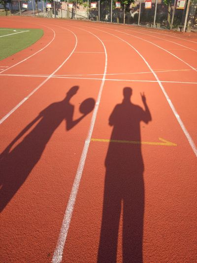 Running Track Shadow Sports Track Sport Track And Field Outdoors Sports Race Day Only Men Sunlight Adults Only Sprinting Red Competition Track And Field Athlete Adult Leisure Activity One Man Only People One Person Second Acts