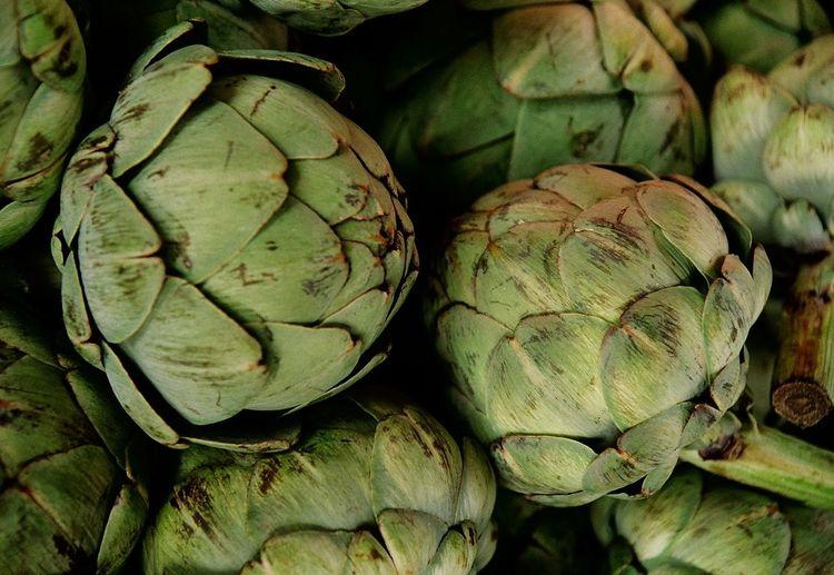 Full frame shot of fresh green artichokes at market