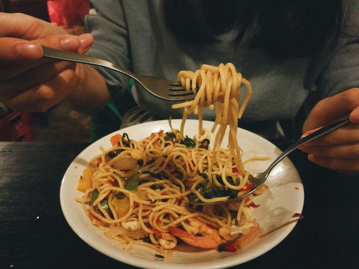 Close-up of man eating food pasta