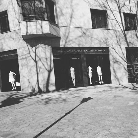 Ermanno Scervino Trees And Buildings City Ghost Barcelona Midday Sunlight Window Shopping Black And White Urbanphotography Passeig De Gràcia