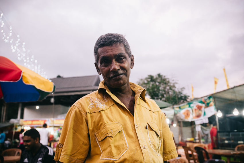 Travel in Sri Lanka Adventure ASIA Day Enjoying Life Exciting Exploration Explore Focus On Foreground Kind Looking At Camera Men One Person Outdoors People Portrait Real People Sky South Asia Sri Lanka Sri Lankan Travel Photography Traveling Yellow The Portraitist - 2017 EyeEm Awards
