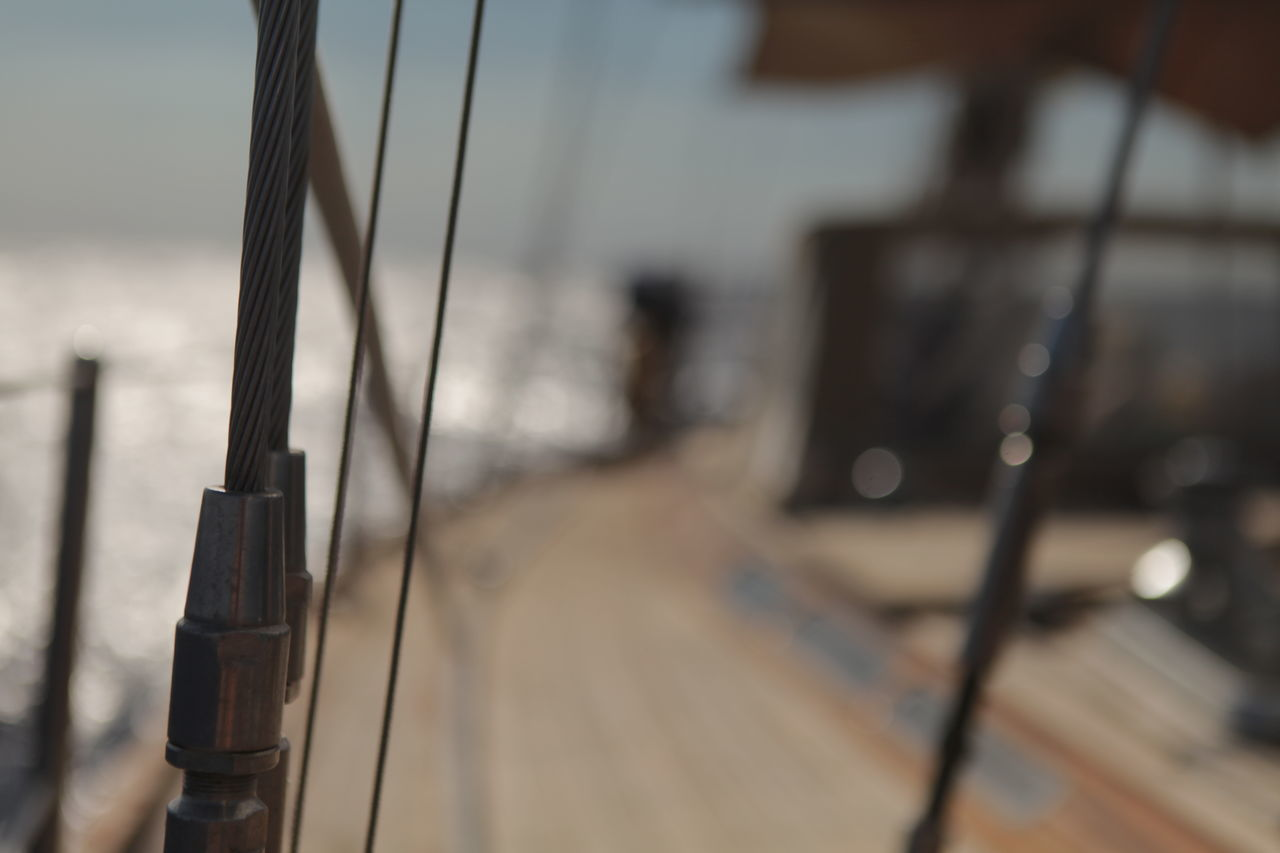 focus on foreground, rope, no people, nautical vessel, sea, wood - material, water, outdoors, day, close-up, nature, sailing ship, sky