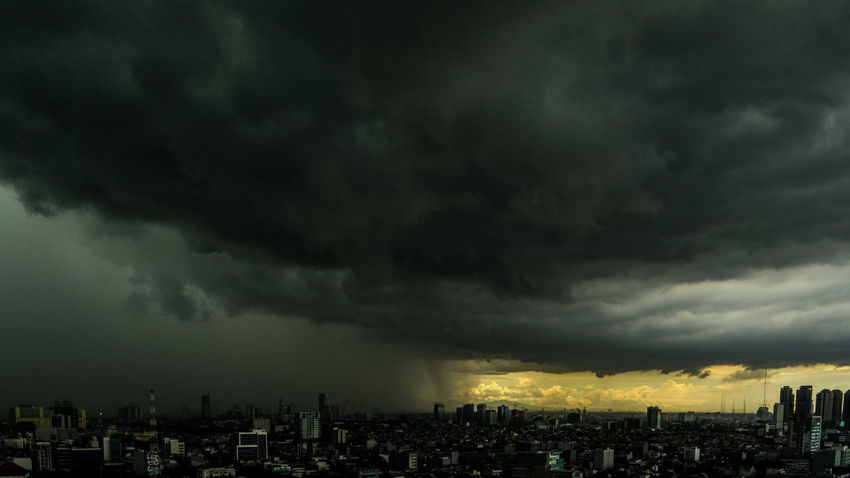 Darkness Consuming The Light... Literally... Beauty Of Darkness Darkness Atmospheric Mood Building Exterior Built Structure City Cityscape Cloud - Sky Darkness And Light Dramatic Sky New Year Eve 2017 No People Ominous Outdoors Sky Skyline Skyscraper Storm Storm Cloud Thunderstorm Urban Skyline Weather
