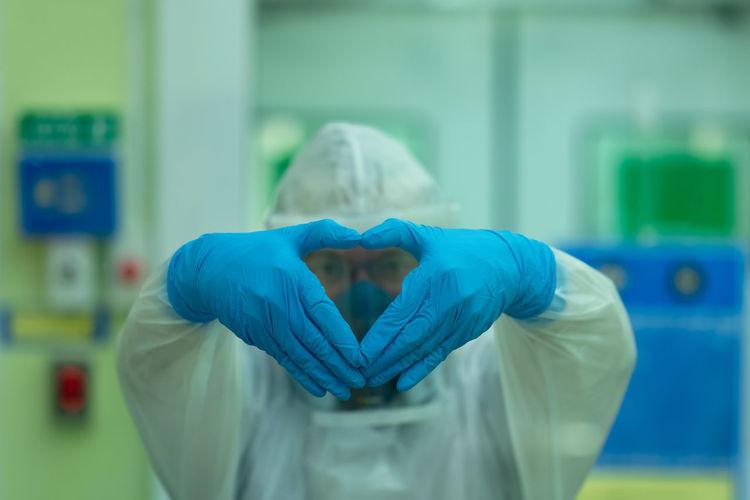 Portrait of man gesturing in laboratory