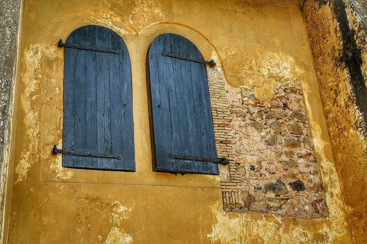 Architecture Built Structure Building Exterior Old Building Window Wall - Building Feature Arch No People History The Past Day Door Closed Yellow Entrance Wall Weathered House Low Angle View