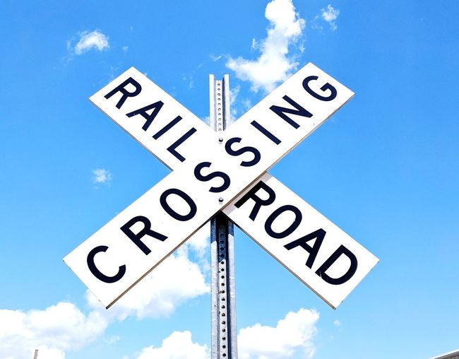 Road Sign Rural Scene One Way Choice Choosing Finding Blue Decisions Guidance Direction Railway Signal Railroad Crossing Street Name Sign Crossing Sign