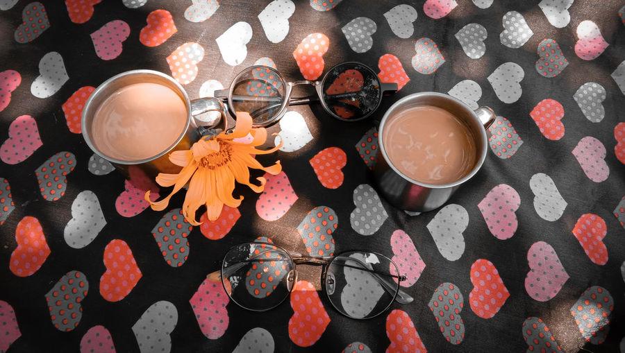 High angle view of tea with eyeglasses on table
