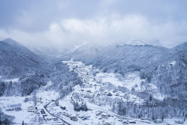 Winter Snow Cold Temperature Mountain Scenics - Nature Beauty In Nature Cloud - Sky Nature Environment Landscape Transportation Sky Day Mountain Range Non-urban Scene Travel Road Car Mode Of Transportation No People Outdoors Snowcapped Mountain Snowing