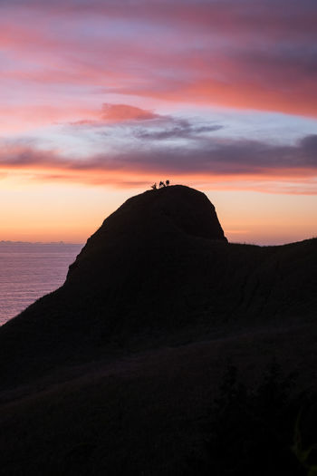 God's Thumb Beauty In Nature Cloud - Sky Dramatic Sky Feel The Journey God's Thumb Idyllic Lincoln City, Oregon Mountain Nature Non-urban Scene Orange Color Oregon Outdoors Scale  Scenics Sky Sunrise Sunset Tourism People And Places Tranquil Scene Tranquility Adventure Club Travel Destinations Original Experiences Perspectives On Nature Be. Ready.