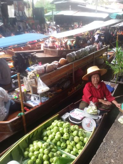 Abundance Choice Day Floating Market Dumnoen Saduak Food Food And Drink For Sale Freshness Healthy Eating Lifestyles Looking At Camera Market Market Stall Occupation One Person Outdoors People Portrait Real People Retail  Selling Small Business Variation Women